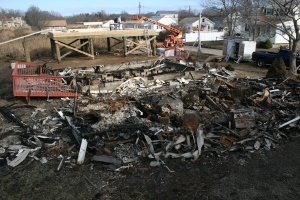 Remains of two Chalker Beach cottages burned to the ground.