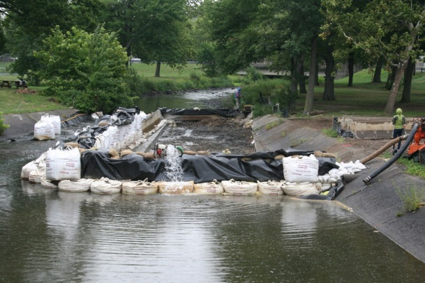 """One of the most difficult tasks was the construction of a """"cofferdam"""" to keep water out of the construction site. At this point in construction, the concrete apron has been removed and the site dewatered."""
