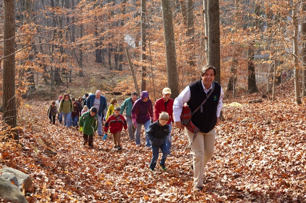 Phil Miller, former First Selectman of Essex and current State Representative, leads a hike in The Preserve. Photo Credit Bob Lorenz.