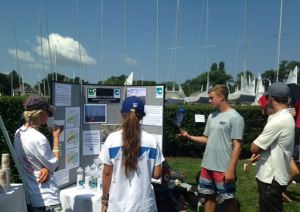 Sailors explaining the Save the Sound display at a regatta.