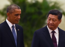 Presidents Obama and Xi announced a major joint climate agreement last week. GREG BAKER/AFP/Getty Images, via Huffington Post.