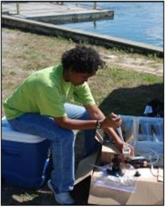 Dr. Croxton setting up a field experiment on the edge of Milford Harbor.