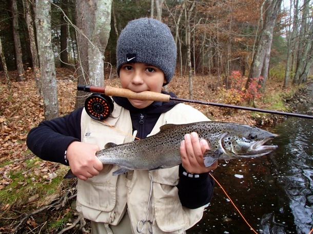 What it's all about! A young angler with a salmon raised at Kensignton Hatchery (photo credit: Bill Smyrnow)