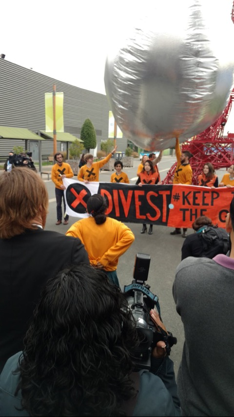 Divestment action at COP21 (I'm the one with my fist raised). Photo courtesy of Bill McKibben.